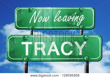 Leaving tracy, green vintage road sign with rough lettering