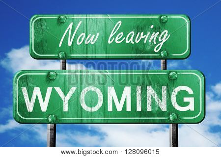 Leaving wyoming, green vintage road sign with rough lettering