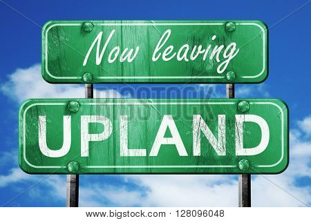 Leaving upland, green vintage road sign with rough lettering