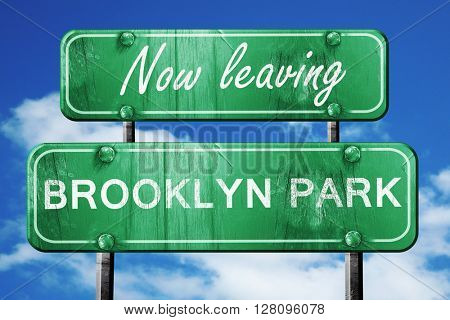 Leaving brooklyn park, green vintage road sign with rough letter