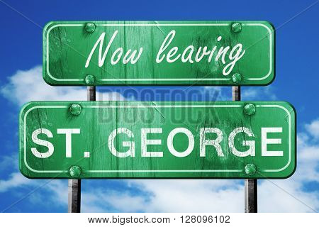 Leaving st. george, green vintage road sign with rough lettering