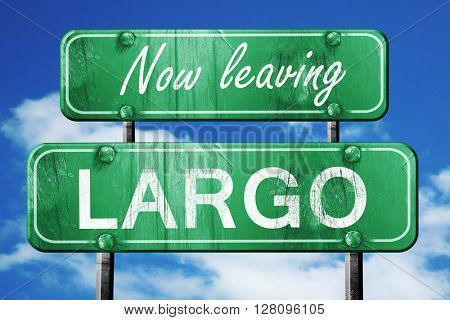 Leaving largo, green vintage road sign with rough lettering