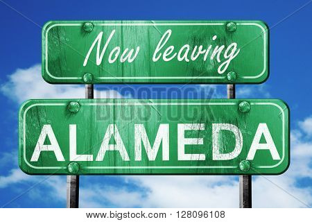 Leaving alameda, green vintage road sign with rough lettering