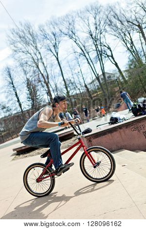 BMX rider athlete riding his bmx bike approaching a jump. ** Note: Soft Focus at 100%, best at smaller sizes