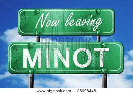 Leaving minot, green vintage road sign with rough lettering