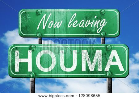 Leaving houma, green vintage road sign with rough lettering