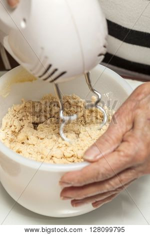 Cookies preparation : Mixing cookie's dough with a hand mixer