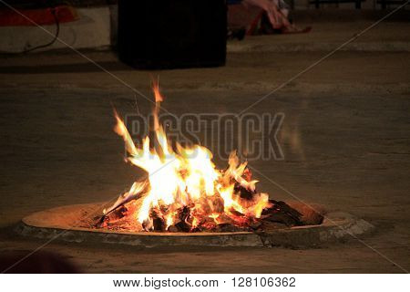 Yellow and red hot flames at winter campfire