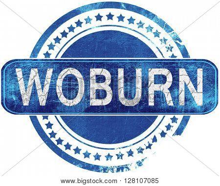 woburn grunge blue stamp. Isolated on white.