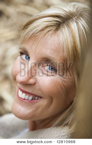 Head shot of middle-aged Caucasian woman smiling.