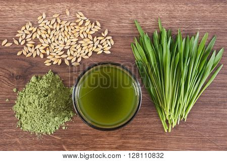 Barley grass with cup of beverage and grain with young powder barley healthy nutrition and lifestyle body detox