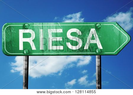 Riesa road sign, 3D rendering, vintage green with clouds backgro