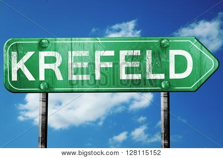 Krefeld road sign, 3D rendering, vintage green with clouds backg