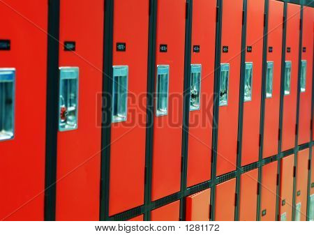 A Row Of Orange Lockers