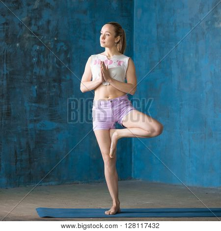 Beautiful Sporty Young Woman Doing Tree Pose