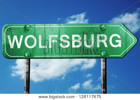Wolfsburg road sign, 3D rendering, vintage green with clouds bac