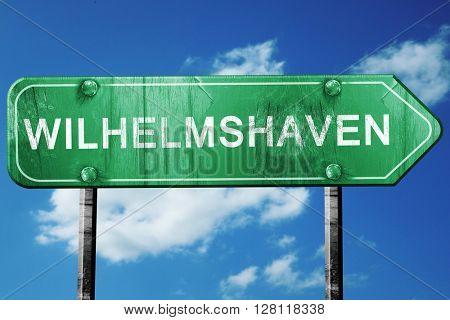 wilhelmshaven road sign, 3D rendering, vintage green with clouds