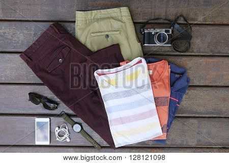 Male summer fashion set on the wooden background