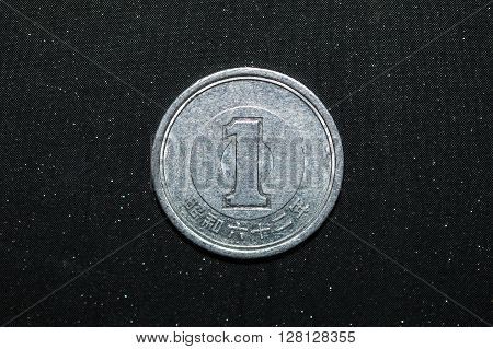 1 japanese yen coins on black color background
