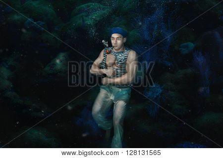 The man the ship's boy under water with a pipe in a mouth.