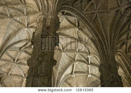 Rib-vaulted ceiling and columns in Jeronimos Monastery in Lisbon, Portugal.