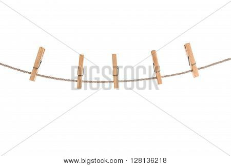 clothespins on rope isolated on a white background.