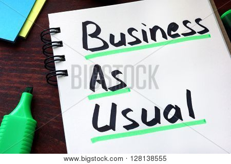 Business As Usual written on a notepad with marker.