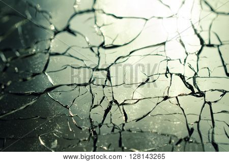 Crackle glass background, the reflection of sunlight through glass