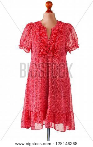 Red casual dress with v-neck. Female mannequin in casual dress. Piece of clothing in workshop. Girl's tailor made garment.