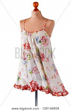 Casual floral pattern sarafan. Vintage sarafan on armless mannequin. Woman's light summer clothing. Garment of lightweight material.