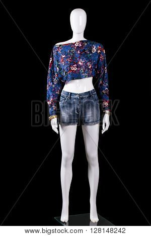 Crop top with denim shorts. Mannequin wearing floral crop top. Girl's stylish summer top. Clothing of high-quality cotton.