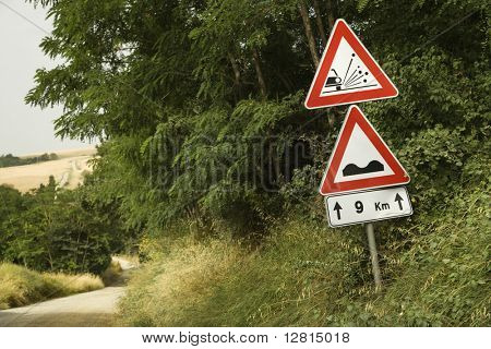 Road sign warnings, Tuscany.