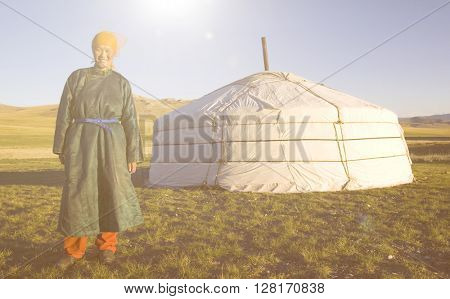 Mongolian Woman Standing In Front Of The Tent Outdoors Concept