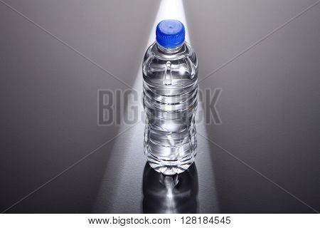 light ray shine on a bottle of mineral water