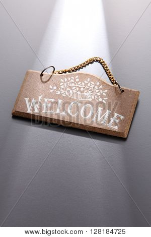 Welcome sign on gray background