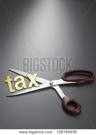Scissor and word TAX on black background
