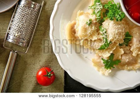 Cooked ravioli with tomato sauce on plat
