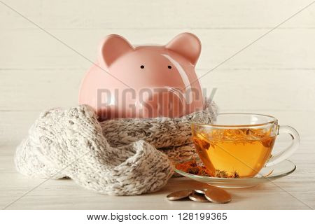 Piggy bank with scarf and pills. Swine Flu concept