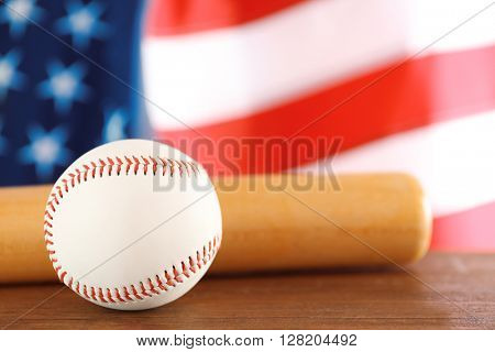 Baseball and bat on background of American flag. Popular sport concept