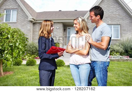 Real Estate agent woman with clients near new house. poster