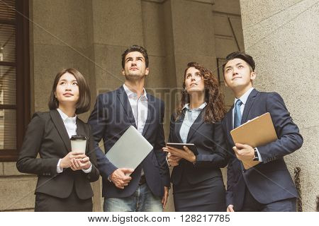 Group of business people looking far away
