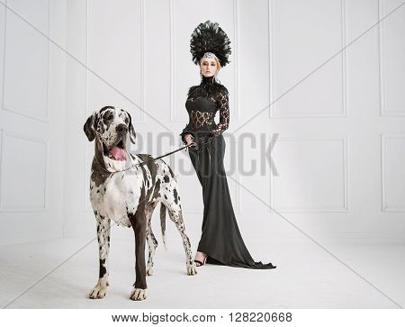 Fashion type photo of a young woman with big dog