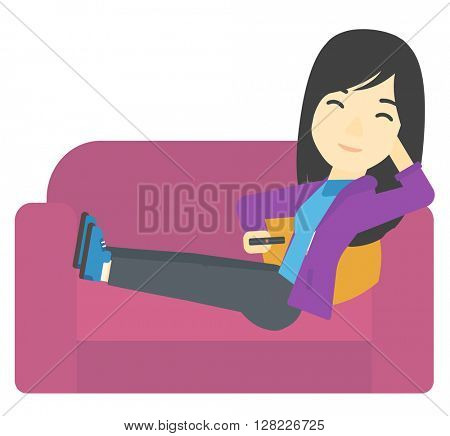 Woman sitting on the couch with remote control.
