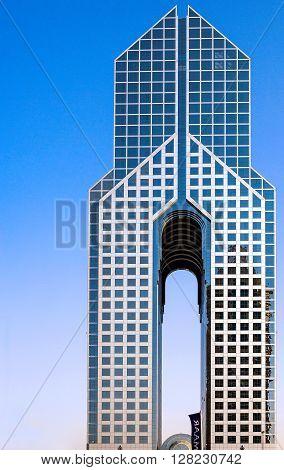 Dubai U.A.E. - November 15 2006: The diaphason shaped Dusit Hotel in the business area of the Sheik Zaied Road.