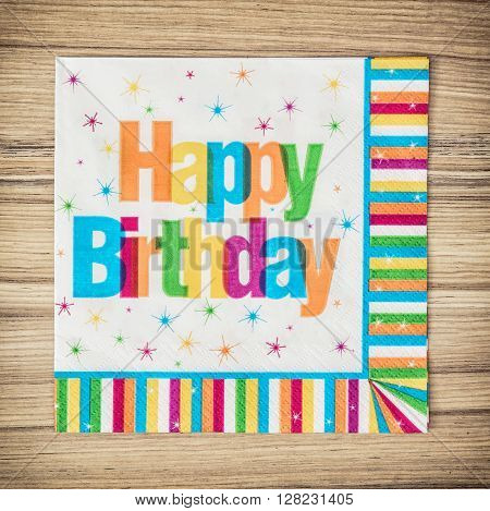 Party napkin with the title happy birthday. Celebration theme. Birthday celebration. Vibrant colors.