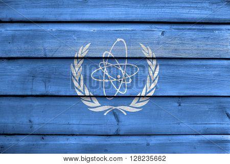 Flag Of The International Atomic Energy Agency (iaea), Painted On Old Wood Plank Background