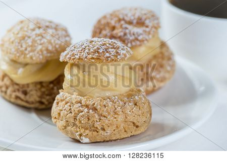 shu pastries with cream with coffee shallow dof
