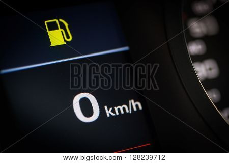 Close-up shot of a fuel pump icon in a car.