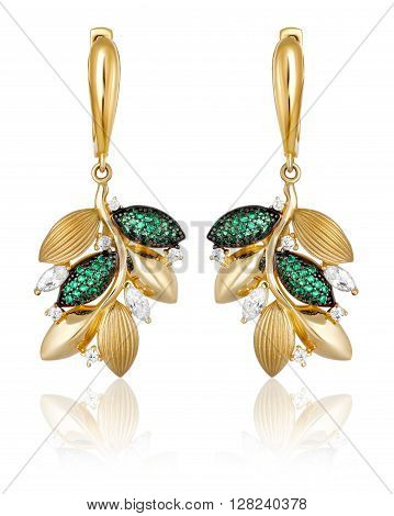 gold earrings with green precious stones on a white background with reflection