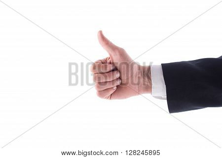 Hand man in a suit giving a thumbs up on a white background.